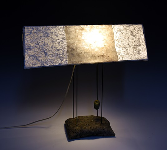 table lamp concrete base painted steel structure hand papered shade  white off white beige  soft light