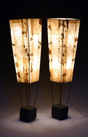stone bases painted steel structures hand decorated paper shades brown beige warm light