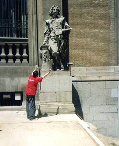 Cypher Bowing In Front of Statue of Velazquez