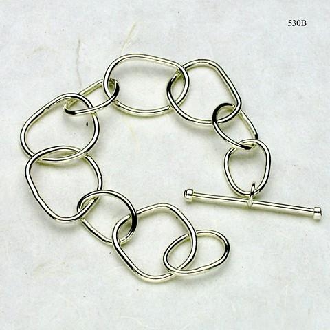 individually forged heavy silver link bracelet with bezel set garnet toggle bar (#530B)
