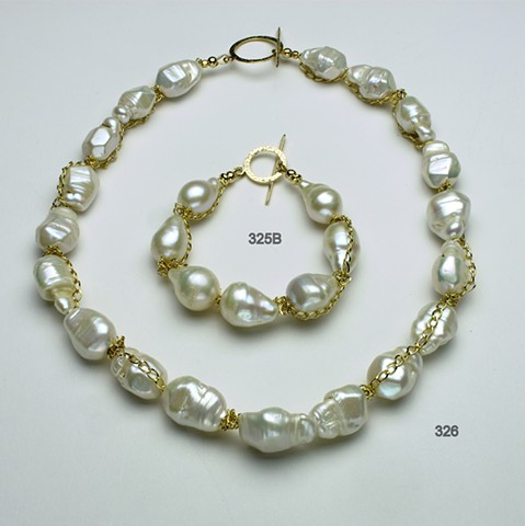 exquisite baroque pearls accented with draped gold filled chain and finished with a gold filled toggle (#326), bracelet (#325B)