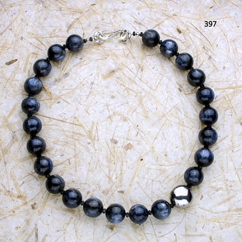 exceptional blue kyanite with handcrafted silver accent bead and faceted iolite, finished with silver clasp ((#397)