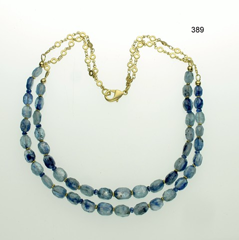 spectacular double strand of faceted blue kyanite accented with vermeil Bali spacers, g/p brass chain & clasp (#389)