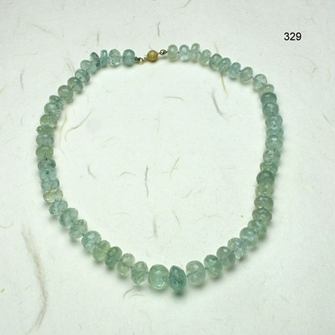 exquisite faceted aquamarine rondelles knotted on silk and finished with a 14kt gold clasp