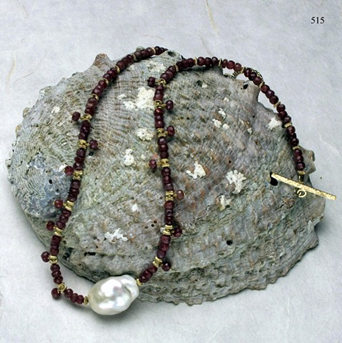 understated elegance; faceted ruby choker w/ baroque pearl centerpiece, accented by dangling rubies and g/f findings (#515)