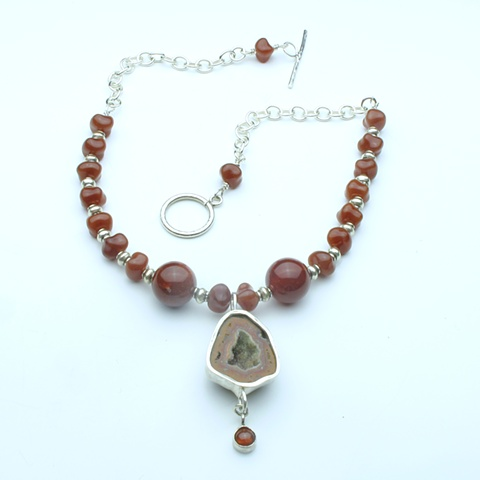 fire and ice:  bezel set geode pendant w/ hessonite garnet drop, vintage glass beads, silver findings