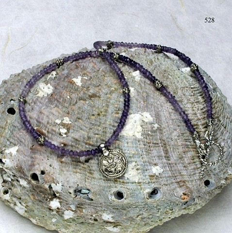 """delicate 151/2"""" choker of faceted amethysts with a antique Indian silver charm, finished with silver beads and toggle (#528)"""