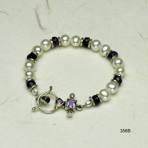 pearl and amethyst bracelet accented wit6h silver beads and finished with bezel set amethyst toggle (#356B)