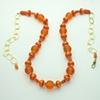 """brilliantly orange""  vintage moon glow lucite, carnelian, orange lucite, vermeil beads, g/f  chain"