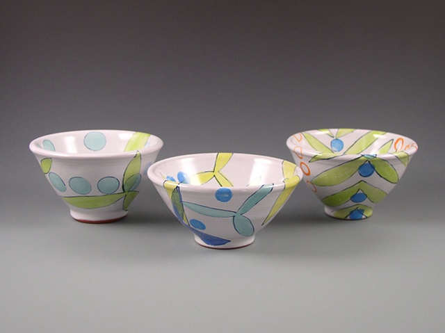 small thrown earthenware bowls or custard cups with majolica glaze