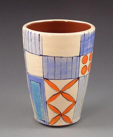 Tumbler, cup, wheel-thrown, handpainted, orange flowers, blue rectangles, stripes, dots