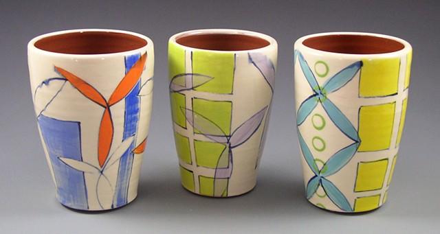 Tumblers, cups, wheel-thrown, handpainted, green, orange, blue, yellow dots, circles, rings, flowers, grid