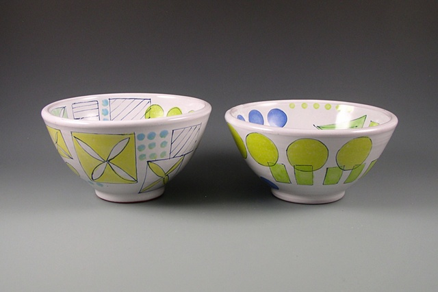 two thrown earthenware bowls with handpainted majolica glaze