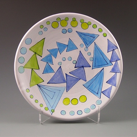 small thrown plate with hand-painted majolica glaze