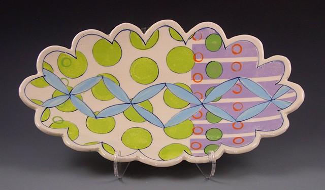 oval platter, large, handbuilt, handpainted decoration, green circles, aqua flowers, lavender stripes,orange rings, geometric, scalloped