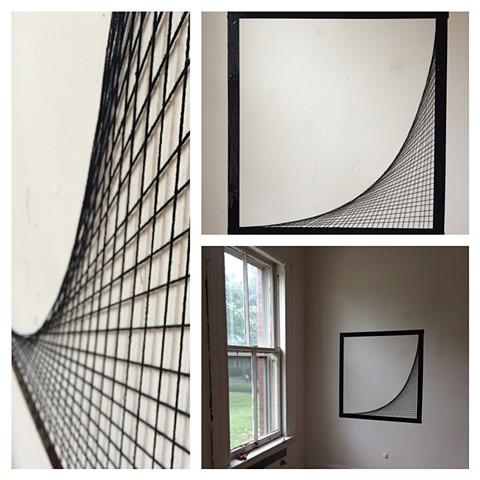 string and tape study on wall
