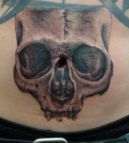 Skull on stomach over belly button