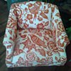 Pair of orange & creme chairs