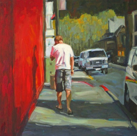 man walking by a bright red building