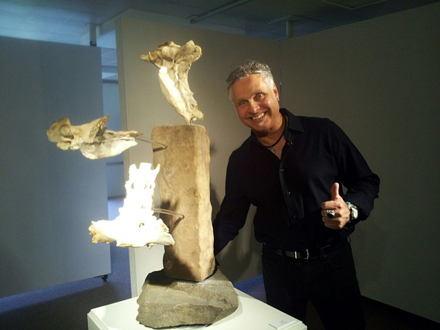 Yanashot with his mixed media sculpture %3 Go 4 It%