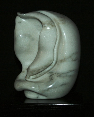 This is a comtemporary stone sculpture of a biomorphic organic form by Denis A. Yanashot.