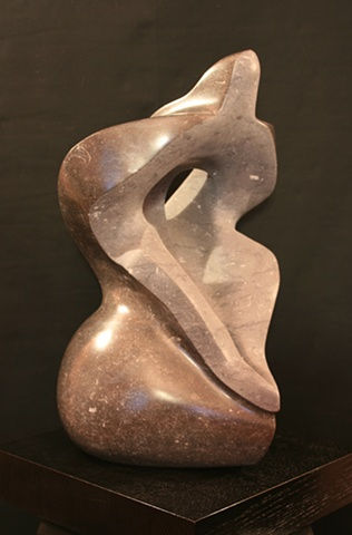 This is a modern contemporary stone sculpture; it consists of abstract plant forms and the human form by Denis A. Yanashot