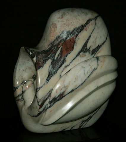 This sculpture is an abstraction of a Catasetum orchid.  It is directly carved in Italian Fantastico Arni Viola Marble by Denis A. Yanashot.