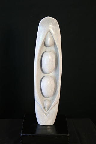This is a modern contemporary stone sculpture of a Peapod by Denis A. Yanashot