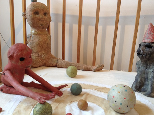 vintage playpen and clay figures