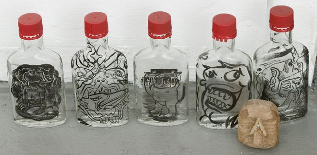 idiosyncratic pre-anthropocene social anxiety in sumi ink on vodka bottles