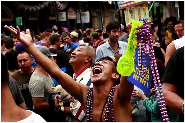 An attendee of Southern Decadence yells at other attendees on a bourbon street balcony in hopes of getting beads. Tropical Storm Lee caused the cancellation of numerous events for Labor Day weekend through out New Orleans and Louisiana. Despite the rain t