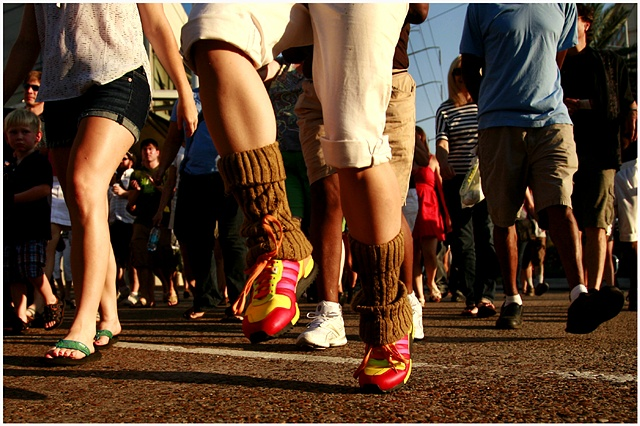 Elsie Semmes' colorful shoes stand out amongst the sea of feet as the second line begins.