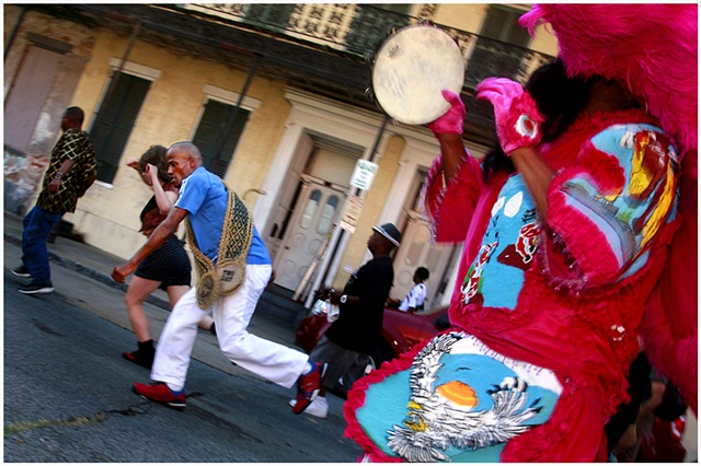 Darryl Young dances down Rampart as Honey plays his tambourine, during a second line celebrating and honoring the grand opening of The New Orleans Healing Center. The second line traveled down Rampart to the New Orleans Healing Center with their arrival k