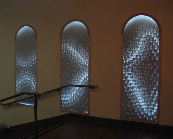 An site-specific installation using light and camera obscuras by Michael Boonstra.