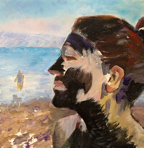 Self-portrait at the Dead Sea with my face covered in mud, evoking a tribal mask