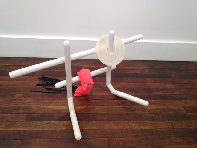 M. Grip, 2012   Wax, wood, exercise shorts, plaster and leather tassle. 19 x 35 x 32 inches