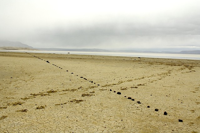 1500 foot line of stones set in the mud flat of Summer Lake, Or., orientated to the north star.  2012. Archival ink jet print, 20x13""