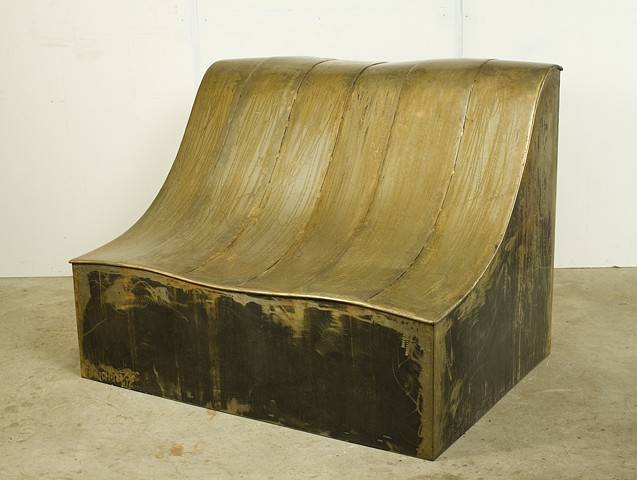 Like the side of a rolling valley, this sculpture invites the viewer to sit and relax. View in the studio.