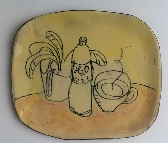 studio plate with plant, cup and bottle