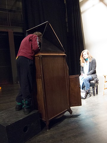A digital photograph by Stephen Takacs of a participant using the Victrola Obscura at the Wexner Center for the Arts in Columbus, Ohio