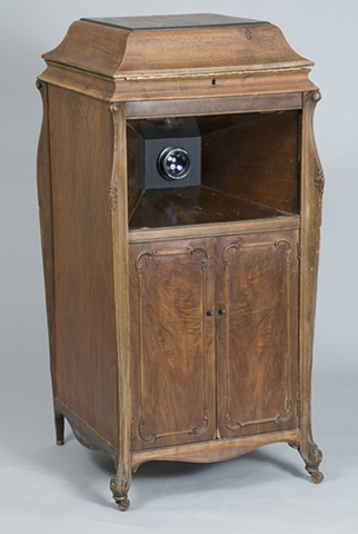 A digital photograph by Stephen Takacs that documents a camera obscura created from a discarded antique Victrola cabinet.