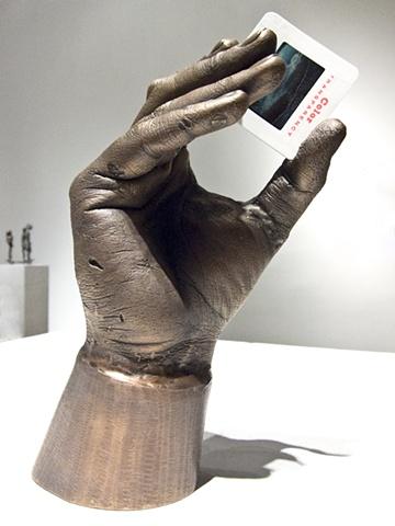 A digital photograph by Columbus Ohio artist and OCAC alumni Stephen Takacs of a bronze hand statue holding a Kodachrome slide