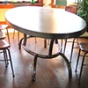Elliptical aluminum dining table