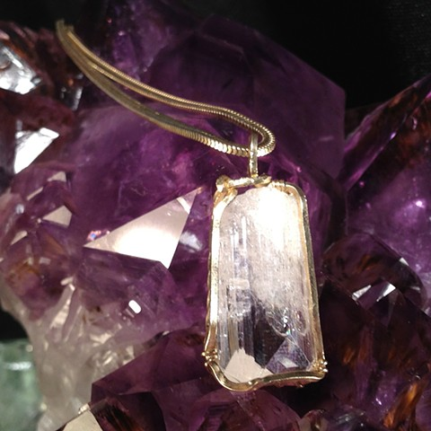 natural uncut Danburite crystal from Mexico wrapped with 18k gold
