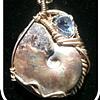 Ammonite w/ Topaz