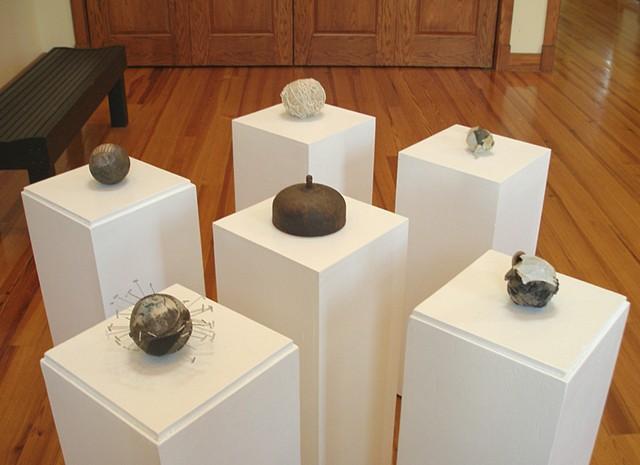 Six abstract sculptures on pedestals