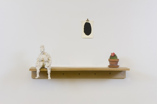 """Bigger Girl"" on shelf with ""Black & Gold Egg""  + cactus, 2015  porcelain, india ink & acrylic on paper, found cactus & mica dust  Fulbright Alumnae Exhibition"