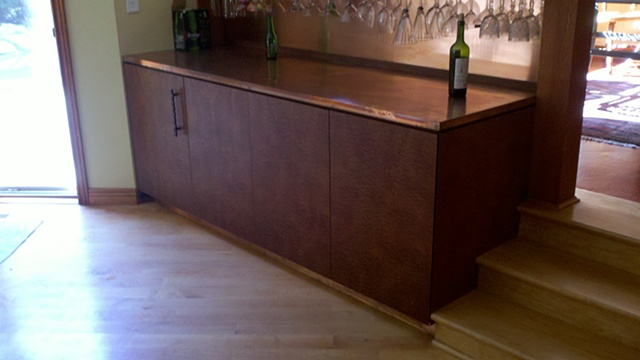 exotic sapele dry bar with copper counter