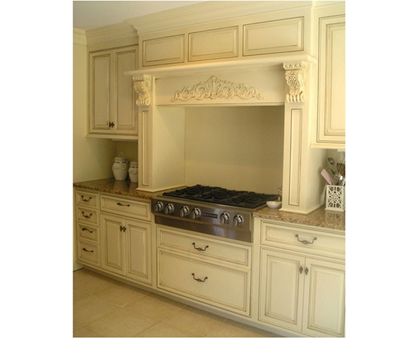 Hood and Cabinetry in white classical style kitchen.