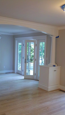 Millwork and decorative column created using FSC certified materials for LEED project.